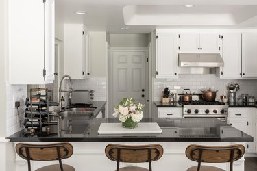 view of kitchen with dark countertops and white cabinets