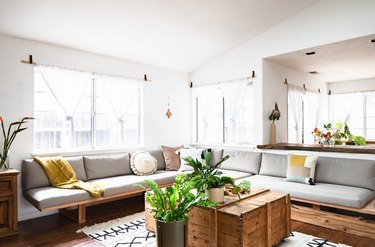 Living room with gray sectional sofa and bohemian decor