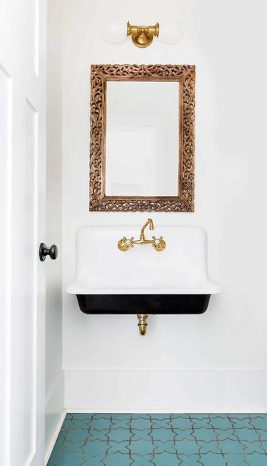 gold and white bathroom mirror lighting ideas above gold mirror in bathroom with blue tile