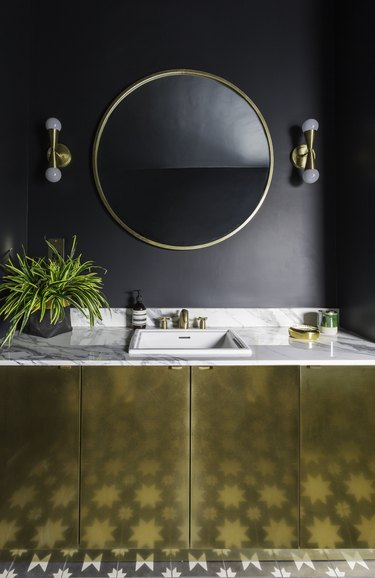 dark blue master bathroom with gold master bathroom vanity