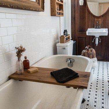 wood bath tray in bathroom