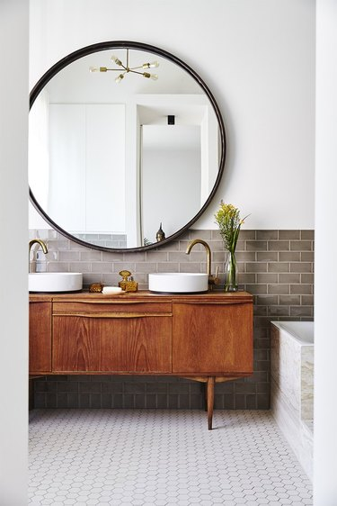 vintage master bathroom vanity with large mirror