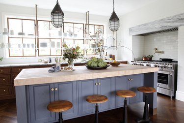 wood traditional kitchen cabinet doors in kitchen with blue island and wood bar stools