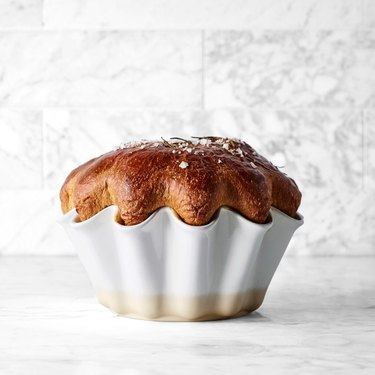 Brioche in a white pan with tiled background