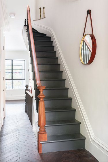 painted stairs with gray steps and riser and wood banister