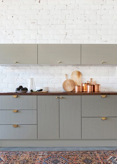 gray traditional kitchen cabinet doors with beadboard and brass handles