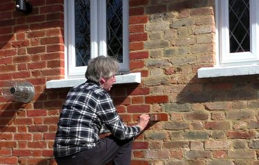 Man applying brick stain