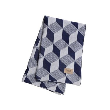 Geometric throw blanket featuring three different shades of blue