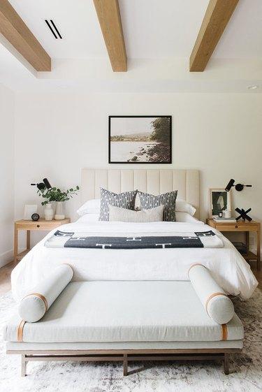 bedroom lighting ideas exposed ceiling beams and upholstered headboard