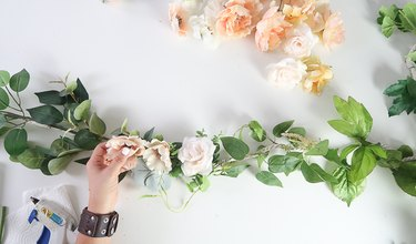 Use hot glue to attach flowers to rope.
