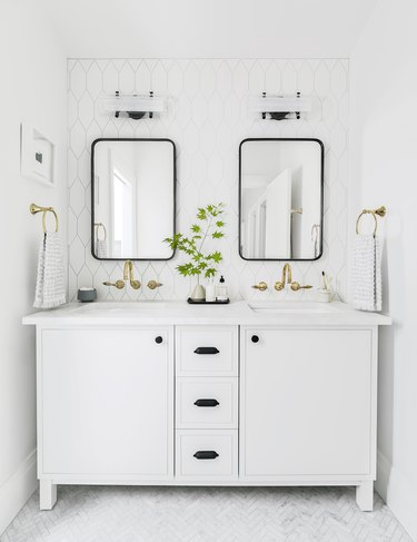 white bathroom idea with double vanity and brass faucets
