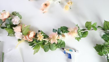 Gluing flowers to garland.