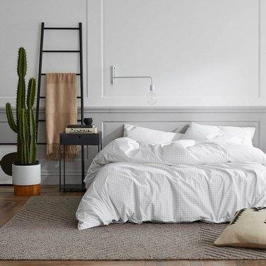 cozy bedroom with white bedding and minimalist decor