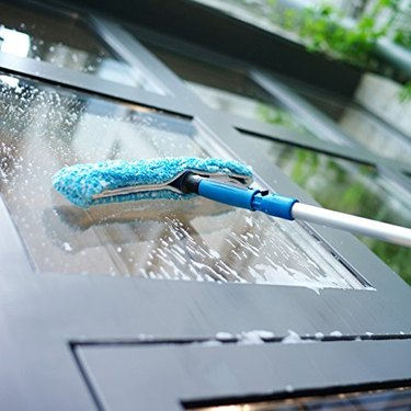 Window scrubber and extension pole manufactured by Unger