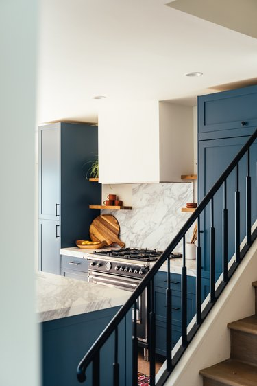 Navy blue painted stair rails in kitchen.