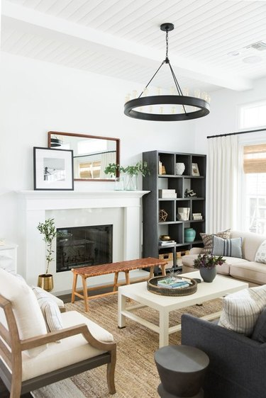 Living room shelving idea near fireplace and sofas