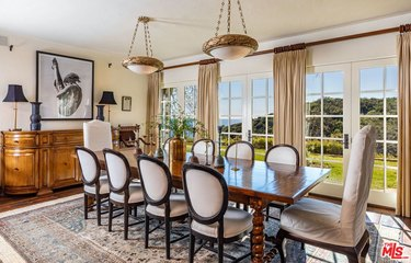 dining room area with large windows