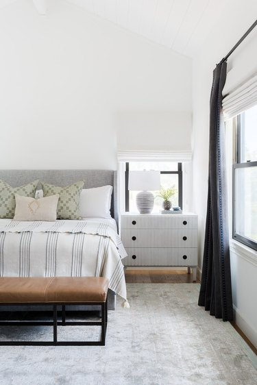 Traditional bedroom with patterned linens and pillows