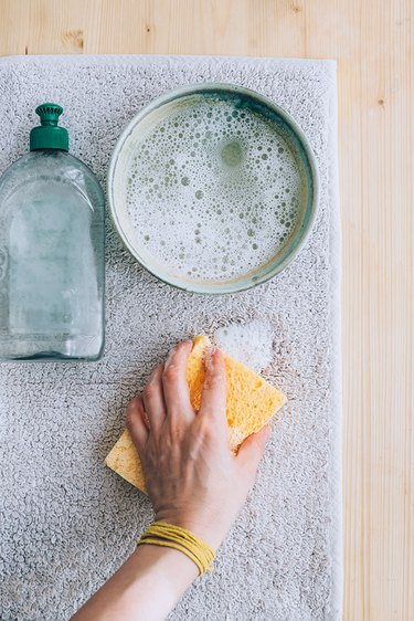 Dilute soap for cleaning carpets