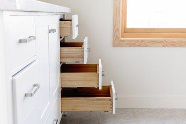 bathroom storage drawers, slightly open