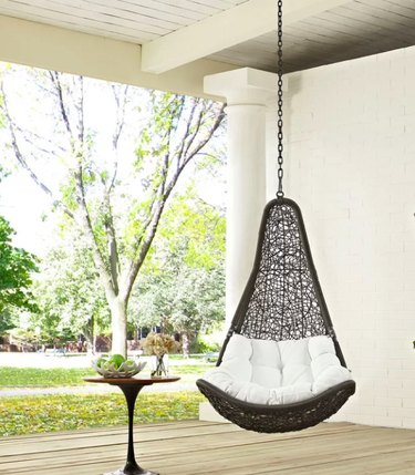 black triangular swing chair with white pillow