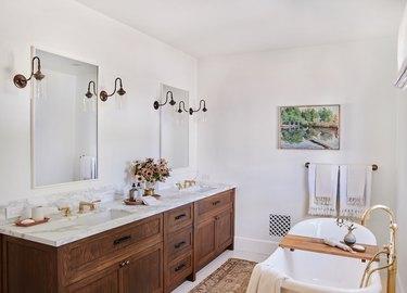 brass bathroom vanity lighting ideas in bathroom with marble and wood vanity