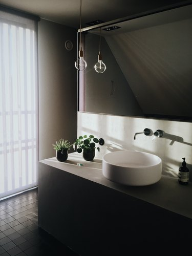 bathroom vanity lighting ideas with plug in pendant and edison bulb over minimal white sink