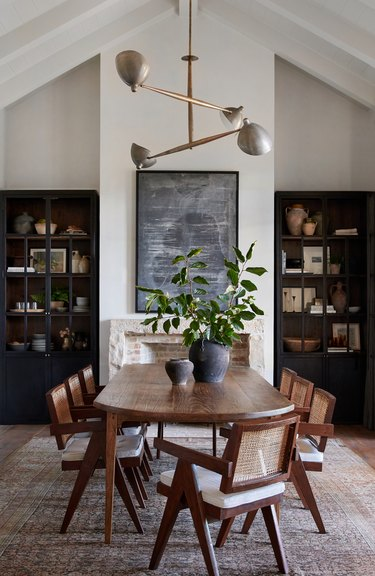 beige and black traditional dining room with large table