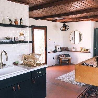living room shelving idea with floating wood shelves in corner