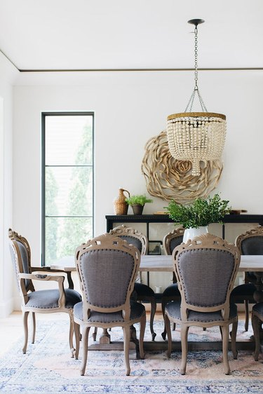 traditional dining room with beaded chandelier