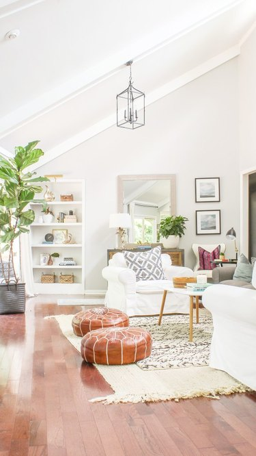 white living room shelving idea with layered rugs
