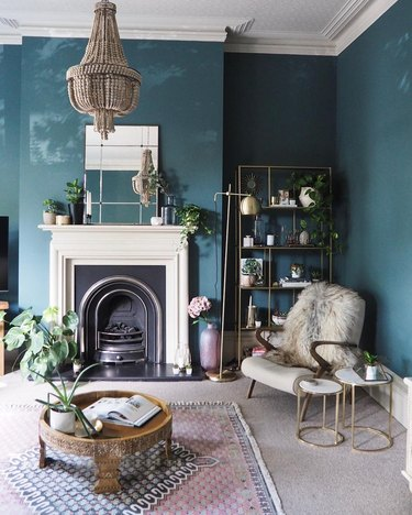 blue living room idea with beaded chandelier and plants