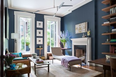 transitional blue living room idea with contemporary pendant and chaise lounge