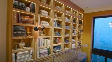 bookshelves near large glass window