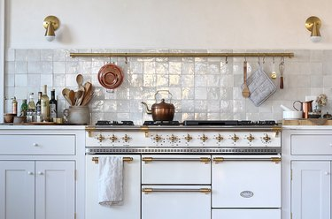 White kitchen design with tile backsplash and French style stove