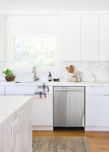 White kitchen design in white marble kitchen