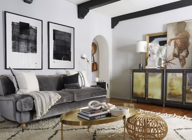 Velvet gray couch living room idea with area rug and artwork