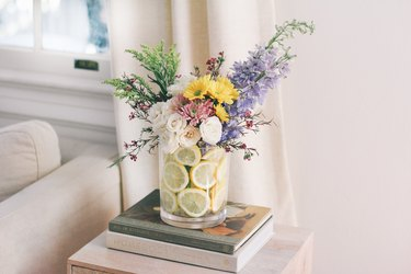 Lemons in a vase with flowers