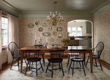 dining room with traditional home decor like patterned wallpaper