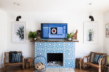 Family room with blue-tiled fireplace and TV layout.