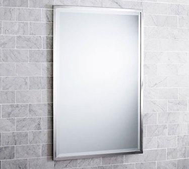Rectangular wall mirror with thin silver border