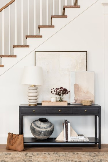 Traditional entryway table with modern ceramic lamp and neutral decor accents