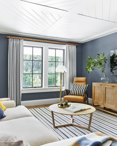 blue living room idea with patterned ceiling