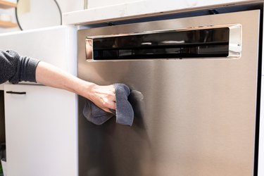 Hand cleaning stainless steel dishwasher