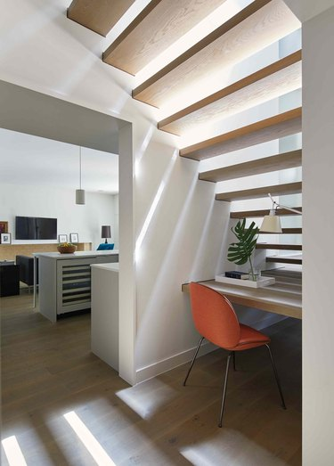 under the stair idea with simple desk and orange chair