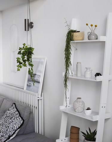 Living room storage ideas with leaning ladder