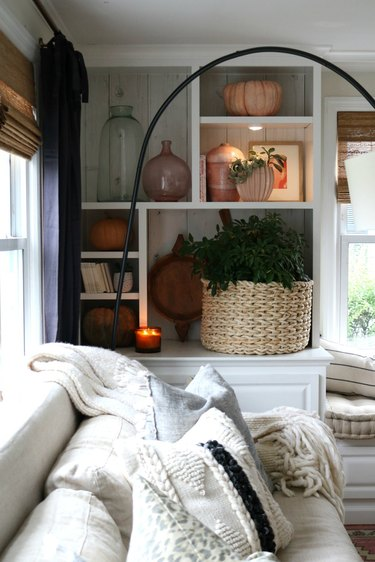 Living room storage ideas with built-in bookcase and cozy sofa