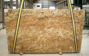 Unfinished granite slab in warehouse.
