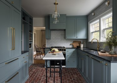 kitchen cabinet color idea with blue cabinets and brick floor