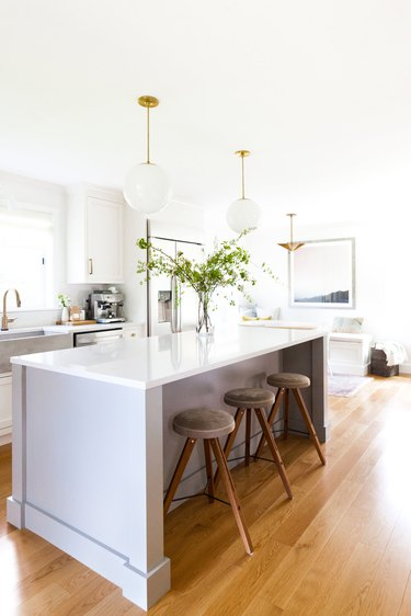 Kitchen island lighting idea with globe pendants